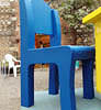 Oversized blue cardboard chair